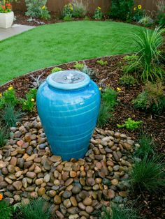 A bright blue and bubbly urn fountain adds color and charm to the landscape in a newly remade San Diego backyard.