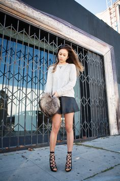 (J Brand sweatshirt, Love Leather perforated leather skirt, Tom Ford lace-up sandals, Theory bag)