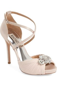 Free shipping and returns on Badgley Mischka 'Cacique' Embellished Sandal (Women) at Nordstrom.com. A dazzling crystal brooch crowns the open toe of an exquisite evening sandal shaped from lustrous satin and designed with slim crisscrossing straps and a wrapped heel.