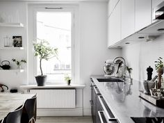 WHITE HOME WITH BLACK KITCHEN