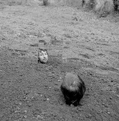 Keith Arnatt, Self Burial with Mirror, 1969