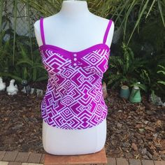 NWT Aqua Couture bathing suit top Brand new Aqua Couture purple and white bathing suit top. Super cute with adjustable straps and white accent buttons on the front. All offers considered. Aqua Couture Swim