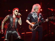 Brian May of Queen and Adam Lambert (L) in concert at Rogers Place in Edmonton, July 4, 2017.