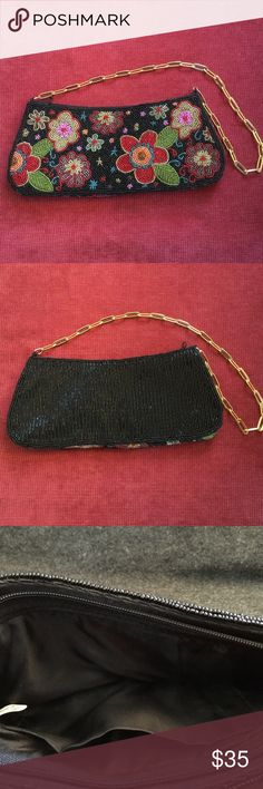 Black Floral Beaded Shoulder Evening Purse This is a floral beaded black evening bag with a gold tone shoulder chain. The flowers are in gold, red, green, pink and blue beads. The interior is black satin and has one open side pocket. No brand label. No Flaws. 10 in wide, 4 in high (794) Bags Shoulder Bags