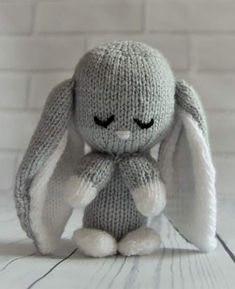 Knitting Pattern for Baby Bunny - Rabbit toy with long floppy ears. DK yarn. Measures approx 15cm high. Designed by TobyCreates