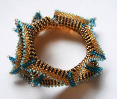 08-13-13 Baby Sea Serpent - I had a short piece of memory wire and some left over size 11 beads.