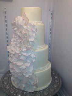 Cascading Flower Cake | Little Delights Cakes. Show to make perfect fondant flowers/petals.