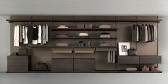 brown aluminum structure, back panels and shelves in coal larch melamine finish. Drawer units in coal larch melamine finish with top in regenerated castoro leather