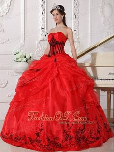 Beautiful Red and Black Quinceanera Dress Strapless Floor-length Organza Appliques Ball Gown  http://www.fashionos.com  http://www.facebook.com/quinceaneradress.fashionos.us  Gorgeous quinceanera gown with a strapless neckline and nice embroidery accenting the bodice.The symmetrical lines and pleated bust give this dress strong visual impact.The full skirt features bubble top and embroidered hem. A lace up back completes the look.