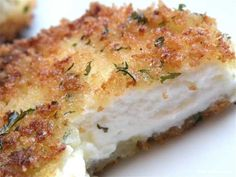 Crispy Fried Goat Cheese> 16 oz. goat cheese log  1 cup panko bread crumbs  2 tsp. dried parsley  1 tsp. dried thyme  1/2 tsp. granulated garlic  1/2 tsp. ground white pepper  pinch of kosher salt  2 eggs, beaten  1/2 cup of flour  olive oil