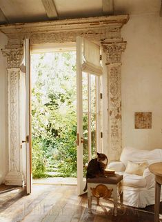 Wonderful architectural salvaged pieces framing this french door