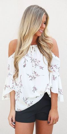 cool outfit floral blouse + black shorts | A cold shoulder blouse that covered with flowers all the way down