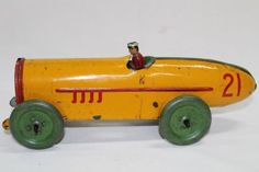"""clockwork racing car with boat tail & driver. Made by """"Strauss, USA"""".... Click VISIT to find out more and see a wide range of Tin Plate Toys at MAD On Collections... Check us out on Facebook - https://www.facebook.com/Mad-on-Toys-1489499904472091/... Please feel free to pin or share this pin or any other content from MADonC.com. MADonC.com is for passionate collectors of all objects with 1000's of categories on view... #toys #tinplate #tinplatetoys"""