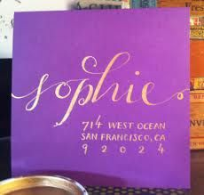 gold #caliigraphy on purple envelopes