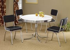This retro chrome plated round table displays distinctive styling. Table features a white finish and chrome rimmed top. Chrome plated chairs...
