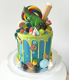 """Everybody Roar"" dinosaur candyland cake! My girls have requested for this cake over a rainbow unicorn princess cake for their birthday next year!"