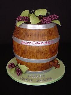 This was for a man who loves to make his own wine. I have been told that it was a total hit at the party and no one could believe that it was a cake. It was two tiers of fruit cake and the base tier was a foam dummy.