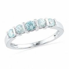 Simple and elegant, celebrate your anniversary with this meaningful band. Fashioned in cool 10K white gold, five exceptional icy blue aquamarines, the traditional gemstone of trust and faithfulness, are channel set atop the ring's polished shank. An amazing gift of love, and polished to a bright shine, let this ring serve as a meaningful reminder of your marriage commitment.
