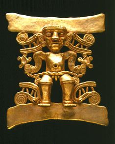 """Gold Pendant of a Shaman Holding a Double-Headed Snake - FJ.6158, Origin: Costa Rican/Panamanian Border Area, Circa: 500 AD to 1550 AD, Dimensions: 3.5"""" (8.9cm) high, Collection: Pre-Columbian, Style: Pre-Columbian, Medium: Gold. The male figure sits with his knees bent, feet extended over the curved lower bar. With both hands he clutches the heads of a stylized snake, the rope-like body of which is draped over his lap and groin area above his exposed genitals."""