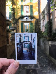 "Traveling Italy with Polaroid. My second stop was Bellagio, on Lake Como. The town was so perfectly ""Italy"" – colorful buildings adorned with vines. Get Lost With Jackie"