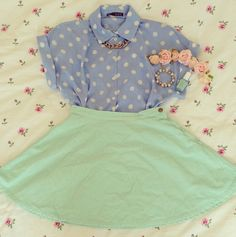 Blue and White Polka-Dot Shirt and Mint Green Skirt with Gold Chain Necklace