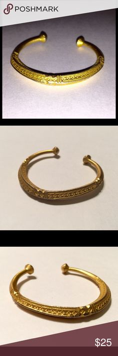 Cernunnos Torc Vintage Tribal Bracelet golden 80s Is this the golden torc of cernunnos? Most likely not! But it sure reminds me of it...purchased in Venice, IT 1980s - most likely African in origin. Some wear to gilt in areas, but a very heavy piece which is well made and gorgeous. Brilliant Byzantine gold. Adjustable, you can squeeze to fit you. Has been in same configuration since I got it, so not weakened by repeated change of size. 2 inches from opening to inner edge of bangle. About…