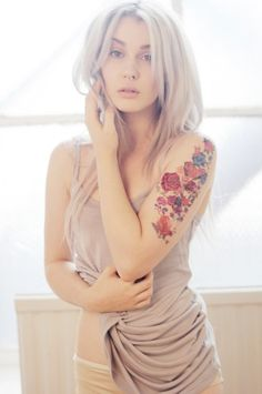 This whole thing. Neutral tones, ash blonde, great floral tattoo, pose.