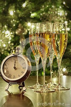 Photo about Champagne glasses, clock with lights at midnight. Image of bottle, sparkle, romantic - 47740146 Happy New Year Pictures, Happy New Year Quotes, Happy New Year Greetings, New Year Greeting Cards, Quotes About New Year, New Year Wishes, Merry Christmas And Happy New Year, Christmas Time, New Years Eve Day