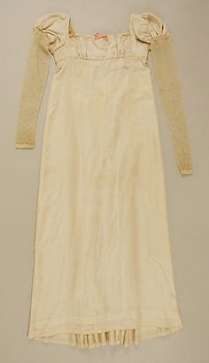 Silk dress with net sleeves, American, 1812. Part of an ensemble with stockings and pink leather slippers.