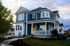 Exterior Colors: blue, white, & yellow door
