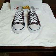 Joe Browns Sneakers NWOT Flower Print Size 10 US These Joe Brown sneakers are NWOT. The base is deep blue with a flower print. Would be great with jeans and shorts or a skirt. Joe Browns Shoes Sneakers