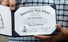 Honorary Bakersfield HS diploma given to Merle Haggard.