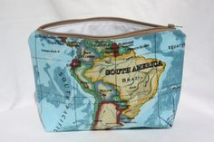 Toiletry bag/wash bag/make up bag with world map oilcloth fabric on the outside and white nylon on the inside.
