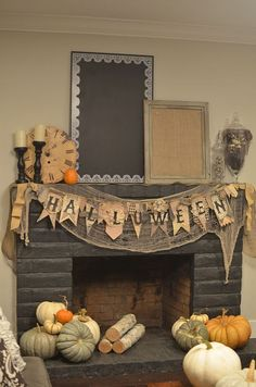 halloween mantel idea...gauze behind the banner is fab & the assortment of pumpkins- LOVE!