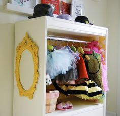 I love this but would sub hooks for hangers to make it more toddler-friendly. DIY Costume Closet via Rambling Renovators