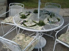 """LEFT IT IN IT'S SHABBY WHITE CONDITION. IT HAS STORE BOUGHT CUSHIONS, PLACEMATS & CLOTH NAPKINS IN A  MATCHING SET. WOULD LOOK GOOD IN ANY SETTING. """"A VINTAGE PIECE"""" IN MY YARD. ALPENA MICHIGAN."""
