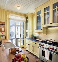 Home Furnishings Light Yellow Cabinetry Sliding French Doors A Commercial Stove And