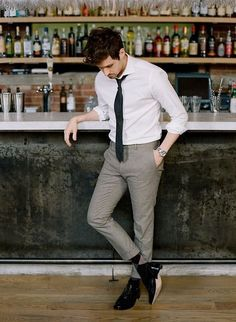 Monochrome style with a black tie white shirt gray pants black shoes and argyle socks #monochrome #minimal #menswear #mensfashion #menstyle #blackandwhite