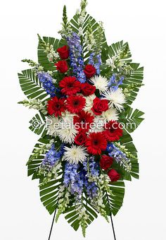 Red, white, and blue funeral standing spray.