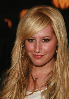Side swept bangs with middle part (Ashley Tisdale)