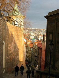 Stately Prague  Scenic view of Old Town Prague from Lesser Town descending the stairs from Prague Castle. Photoscenics ⓒ 2008 Terry Cartwright