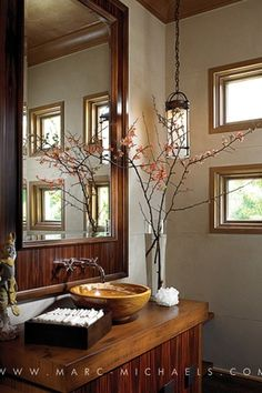 Asian Powder Room with Powder room, Pendant light, Wood counters, Wall sconce, European Cabinets, Wall mirror, Vessel sink