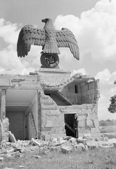 An eagle and swastika tower above part of a damaged grandstand at the former Nazi Party rally site in Nuremberg Germany - History Online, World History, World War Ii, Nuremberg Germany, Modern History, German Army, Interesting History, War Machine, Military History