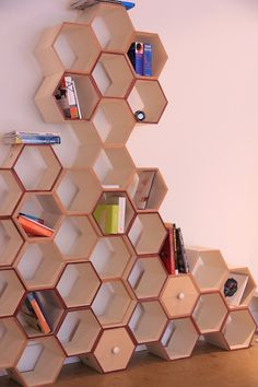 Designed by a graduate of the Boston Architectural College, the Hexy Wall is sold in clusters and can be assembled according to individual needs, with super-magnets for strength and flexibility.