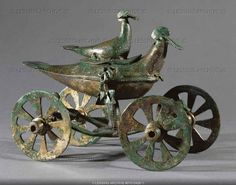 Two birds on a bronze cult chariot from Glasinac, Sarajevo, Bosnia Herzegovina. Length: 18.5 cm (c) Photograph by Erich Lessing