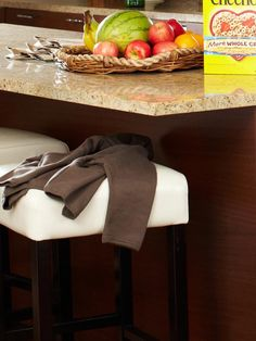 Leather topped bar stools are a comfy, chic, and easy-to-clean addition to your kitchen island.