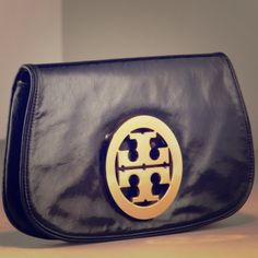 Authentic Tory Burch Classic Black Clutch This chic Tory Burch Clutch is a timeless piece that looks great with everything! It is in excellent condition and would be perfect for a wedding or a night out on the town! Tory Burch Bags Clutches & Wristlets