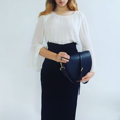 Lorna & Bel black leather bag with inbuilt phone charger - a seamless fusion of fashion and function.  Instagram Image @lornaandbel