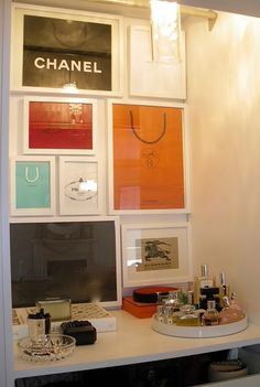Framed shopping bags for your walk in closet decor ; YES