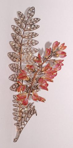 Boucheron c1898 | Diamond leaves set in silver over gold, opalescent and transparent pink plique-a-jour enamel blossoms.